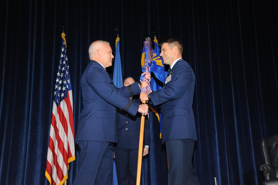Commander of 22nd Air Force, Maj. Gen. John Stokes (left) transfers command of the 908th Airlift Wing to Col. Kenneth Ostrat during an Assumption of Command ceremony March 5 at Maxwell Air Force Base. This is Ostrat's second time with the wing as he was previously the director of operations for the 357th Airlift Squadron from July 2008 until December 2012. (U.S. Air Force photo by Lt. Col. Jerry Lobb)