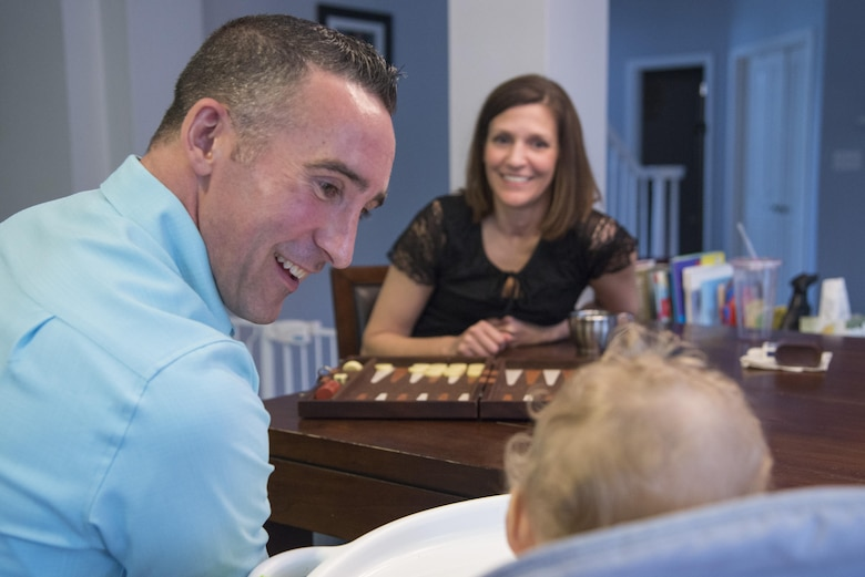 Maj. Thomas Lessner, 39th Flying Training Squadron instructor pilot, talks to his daughter as he plays a game of backgammon with his wife, Kathleen, February 27, 2017.  (U.S. Air Force by Sean M. Worrell)