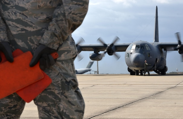 Senior Airman Liam Miner, 920th Aircraft Maintenance Squadron dedicated crew chief, stands by ready to marshall King 52, the first HC-130 configured for Air Force rescue, down the Patrick Air Force Base, Florida, taxiway for the last time March 6, 2017. King 52 will retire at Davis-Monthan Air Force Base, Arizona, with more than 50 years of service. (U.S. Air Force photo/Tech. Sgt. Lindsey Maurice)