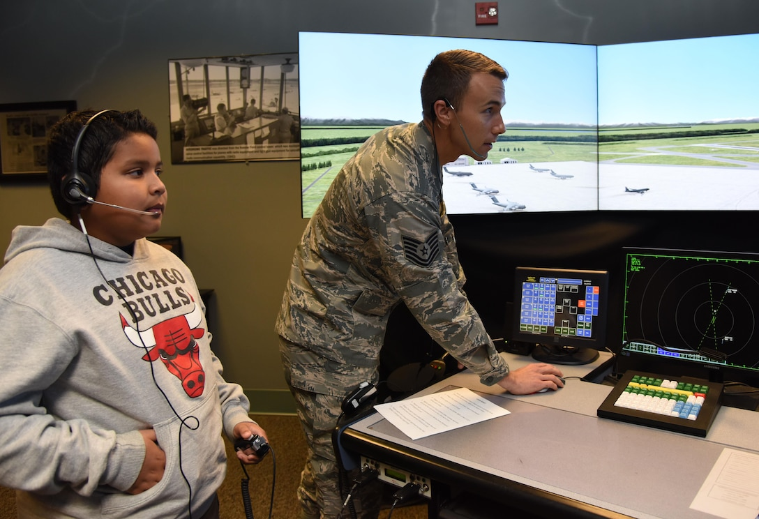 Tech. Sgt. Zach Bickhaus, 334th Training Squadron instructor, demonstrates an air traffic control tower simulation to Kevin Varela-Calderon at Cody Hall during Biloxi Career Exploration Day March 2, 2017, on Keesler Air Force Base, Miss. The school-aged children also toured the 81st Security Forces Squadron canine facility, 335th TRS and the Keesler Fire Department. (U.S. Air Force photo by Kemberly Groue)