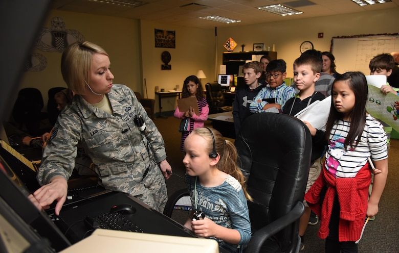 Staff Sgt. Megan Lair, 334th Training Squadron instructor, gives Biloxi school students a demonstration of an air traffic control radar simulator at Cody Hall during Biloxi Career Exploration Day March 2, 2017, on Keesler Air Force Base, Miss. The school-aged children also toured the 81st Security Forces Squadron canine facility, 335th TRS and the Keesler Fire Department. (U.S. Air Force photo by Kemberly Groue)