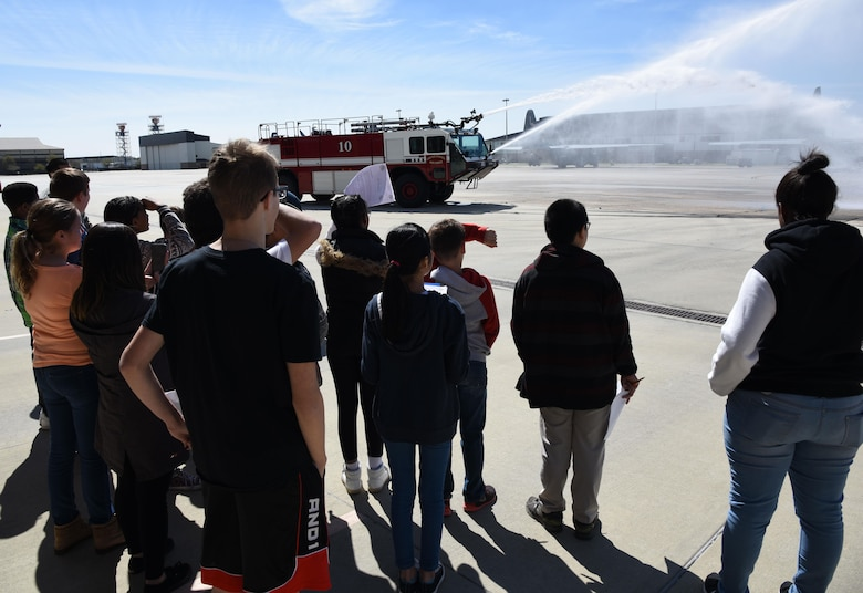 School-aged children watch a demonstration at the Keesler Fire Department during Biloxi Career Exploration Day March 2, 2017, on Keesler Air Force Base, Miss. The children also toured the 334th Training Squadron air traffic control school, 335th TRS weather facility and the 81st Security Forces Squadron canine facility. (U.S. Air Force photo by Kemberly Groue)