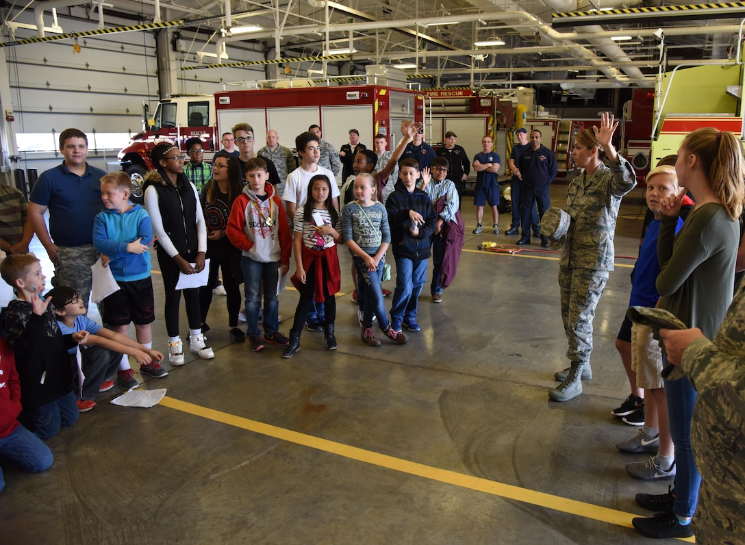 Col. Michele Edmondson, 81st Training Wing commander, quizzes school-aged children about their visit to the installation during Biloxi Career Exploration Day March 2, 2017, on Keesler Air Force Base, Miss. The children also toured the 334th Training Squadron air traffic control school, 335th TRS weather facility and the 81st Security Forces Squadron canine facility. (U.S. Air Force photo by Kemberly Groue)