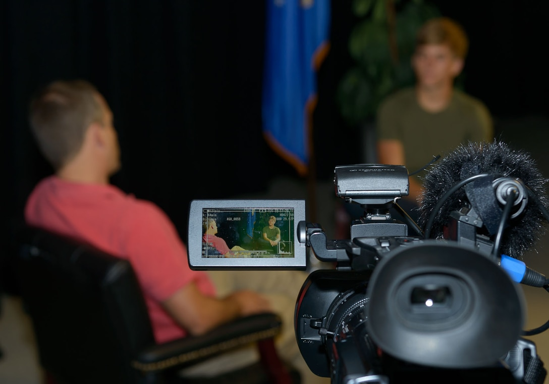 Andrew Whitman, 81st Training Wing television producer and director, conducts a mock interview with Mac Smith, son of Col. C. Mike Smith, 81st TRW vice commander, during Biloxi Career Exploration Day at Wall Studio, March 2, 2017, on Keesler Air Force Base, Miss. The children shadowed their parents and 81st TRW executive officers throughout the day to get a better understanding of what they do on a day-to-day basis to complete the Air Force mission. (U.S. Air Force photo by André Askew)