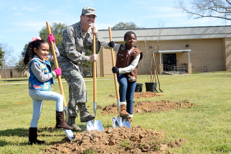 Col. Donald Lewis, 42nd Mission Support Group commander, and Montgomery Area Girl Scouts, Aria Keeler and Chloe Minnifield, commemorate Arbor Day by planting trees at the base Air Park, March 4, 2017, Maxwell Air Force Base, Ala. Lewis presided over the base's annual Arbor Day ceremony and helped plant six new trees with help from Keeler, Minnifield and other event attendees. (U.S. Air Force photo/ Senior Airman Alexa Culbert)