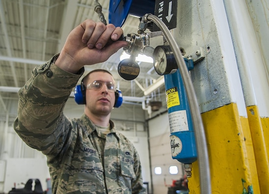 Senior Airman Daniel Moore, 5th Maintenance Squadron hydraulics journeyman, turns off an air compression machine at Minot Air Force Base, N.D., Feb. 23, 2017. After inspecting the hoses, pneudraulics Airmen blow air through them to ensure each hose is completely dry from water. (U.S. Air Force photo/Airman 1st Class Jonathan McElderry)