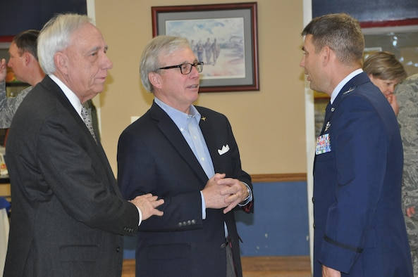 Area civic leader, Tom Albrecht (left) and retired 908th Airlift Wing Mission Support Group commander, Col. Don Brown (center) congratulate Col. Kenneth Ostrat, commander of the 908th Airlift Wing. Congratulations were in order following Ostrat's Assumption of Command ceremony March 5 at Maxwell Air Force Base. (U.S. Air Force photo by Bradley J. Clark)