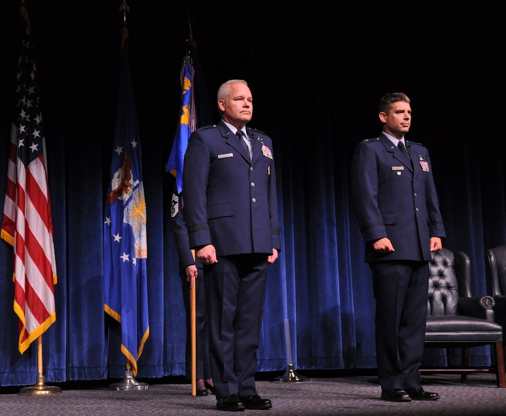 Commander of 22nd Air Force, Maj. Gen. John Stokes (left) prepares to transfer command of the 908th Airlift Wing to Col. Kenneth Ostrat during an Assumption of Command ceremony March 5 at Maxwell Air Force Base. Ostrat returns to the wing having previously been the director of operations for the 357th Airlift Squadron from July 2008 until December 2012. (U.S. Air Force photo by Staff Sgt. Malia Belton)