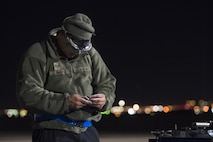 U.S. Air Force Staff Sgt. Samuel Clements, 20th Aircraft Maintenance Squadron avionics specialist, Shaw Air Force Base, S.C. uses light from a headlamp to select an appropriate tool while conducting repairs on an F-16CM Fighting Falcon in support of Red Flag 17-2 at Nellis AFB, Nev., Feb. 28, 2017. Red Flag provides an opportunity for 20th Fighter Wing aircrew and maintainers to enhance their tactical operational skills by exposing them to a simulated combat environment. (U.S. Air Force photo by Senior Airman Zade Vadnais)