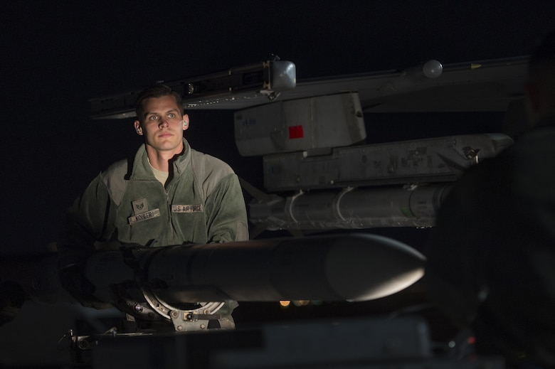U.S. Air Force Staff Sgt. Jeffrey Kohler, 20th Aircraft Maintenance Squadron weapons load crew member, Shaw Air Force Base, S.C. removes an AIM-120 advanced medium-range air-to-air missile from an F-16CM Fighting Falcon in support of Red Flag 17-2 at Nellis Air Force Base, Nev., Feb. 28, 2017. While participating in Red Flag, weapons load crew members have the opportunity to work with live munitions as opposed to the dummy munitions they practice with at Shaw. (U.S. Air Force photo by Senior Airman Zade Vadnais)