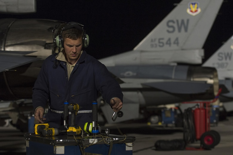U.S. Air Force Airman 1st Class Jesse Fraley, 20th Component Maintenance Squadron aerospace propulsion technician, Shaw Air Force Base, S.C. prepares to put away his tools after completing routine maintenance on an F-16CM Fighting Falcon in support of Red Flag 17-2 at Nellis AFB, Nev., Feb. 28, 2017. Red Flag provides a series of intense air-to-air scenarios for aircrew and ground personnel in an effort to increase their combat readiness and effectiveness for future real-world missions. (U.S. Air Force photo by Senior Airman Zade Vadnais)