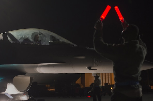 A U.S. Air Force pilot assigned to the 55th Fighter Squadron taxis onto the runway in preparation for a nighttime flying mission in support of Red Flag 17-2 at Nellis Air Force Base, Nev., Feb. 28, 2017. In addition to daytime operations, Red Flag conducts training exercises during hours of darkness to train for low-visibility environments. (U.S. Air Force photo by Senior Airman Zade Vadnais)