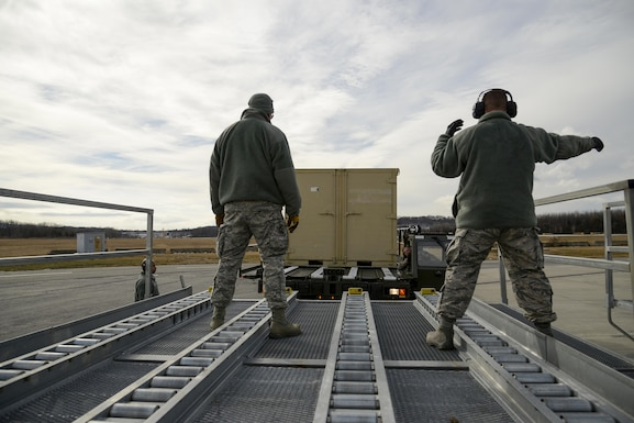 Tech. Sgt. Michael Byerwalters, an air transportation specialist assigned to the 109th Airlift Wing, docks a loaded Turner 60k aircraft cargo loader under the supervision of air transportation specialists from the 105th Airlift Wing during refresher training at Stewart Air National Guard Base, Newburgh, New York Feb. 8, 2017. The 105th Airlift Wing trains between 20 and 30 Airmen on the 60k loader from across the Air National Guard annually. (U.S. Air Force photo by Staff Sgt. Julio A. Olivencia Jr.)