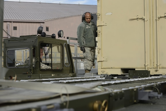 Tech. Sgt. Michael Byerwalters, an air transportation specialist assigned to the 109th Airlift Wing, operates a Turner 60k aircraft cargo loader to load a container under the supervision of Tech. Sgt. Owen White, an air transportation specialist assigned to the 105th Airlift Wing, during refresher training at Stewart Air National Guard Base, Newburgh, New York Feb. 8, 2017. Units from across the Air National Guard send Airmen to Stewart for initial and refresher training on the 60k loader. (U.S. Air Force photo by Staff Sgt. Julio A. Olivencia Jr.)