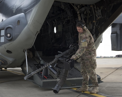 Staff Sgt. Justin O'Brien, 7th Special Operations Squadron special mission aviator, performs preflight checks on a CV-22 Osprey's ramp-mounted weapon system, a .50-caliber GAU-21 heavy machine gun Mar. 7, 2017, on RAF Mildenhall, England. When assigned to the tail position of the aircraft, SMAs are responsible for operating the RMW, weight and balance, clearing the landing zone and alternate insertions and extraction methods, among other duties. (U.S. Air Force photo/Capt Chris Sullivan)
