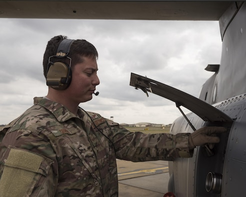 Staff Sgt. Justin O'Brien, 7th Special Operations Squadron special mission aviator, inspects the fuel port of CV-22 Osprey Mar. 7, 2017, on RAF Mildenhall, England. CV-22 SMAs perform a diverse set of duties which vary depending on which of the two crew positions they are assigned for on a mission. (U.S. Air Force photo/Capt Chris Sullivan)