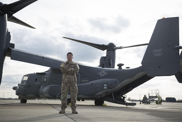 Staff Sgt. Justin O'Brien, 7th Special Operations Squadron special mission aviator, stands in front of a CV-22 Osprey Mar. 7, 2017, on RAF Mildenhall, England. The CV-22 is a tiltrotor aircraft that combines the vertical takeoff, hover and vertical landing qualities of a helicopter with the long-range, fuel efficiency and speed characteristics of a turboprop aircraft. (U.S. Air Force photo/Capt Chris Sullivan)