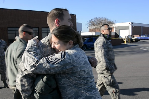 U.S. Air Force Chief Master Sgt. Susan Dietz (right), 145th Medical Group, hugs her son, Senior Airman Jonathan Dietz (left), 145th Aircraft Maintenance Squadron, on the flightline before he boards a C-130 Hercules aircraft at the North Carolina Air National Guard Base, Charlotte Douglas International Airport, Feb. 23, 2017. Airmen of the 145th Airlift Wing are deploying in support of Operation Freedom's Sentinel to provide tactical airlift in the region.