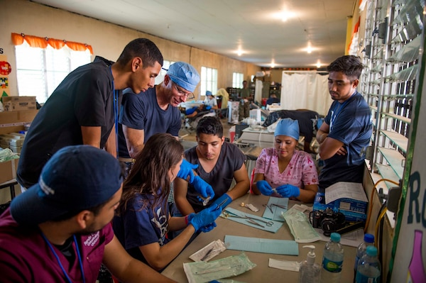 TRUJILLO, Honduras (Feb. 25, 2017) Cmdr. Christopher Crecelius, assigned to Walter Reed National Military Medical Center, Bethesda, Md., conducts a dental procedure training session for Honduran residents during Continuing Promise 2017 (CP-17) in Trujillo, Honduras. CP-17 is a U.S. Southern Command-sponsored and U.S. Naval Forces Southern Command/U.S. 4th Fleet-conducted deployment to conduct civil-military operations including humanitarian assistance, training engagements, and medical, dental, and veterinary support to Central and South America. (U.S. Navy photo by Mass Communication Specialist 2nd Class Shamira Purifoy/Released)