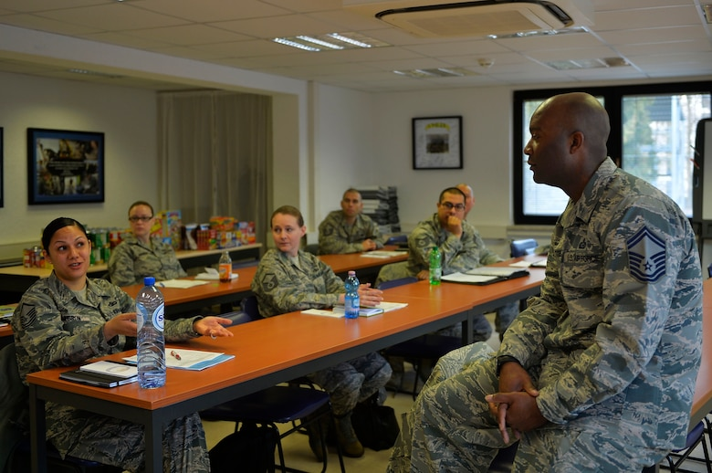 Senior Master Sgt. DeMarcus Tate, U.S. Air Forces in Europe and Air Forces Africa superintendent of military personnel branch, conducts a briefing during a professional enhancement seminar on Ramstein Air Base, Germany, March 7, 2017. Newly promoted Master Sergeants met to in order to gain additional leadership skills and refresh themselves on what it means to be part of the Air Force's highest enlisted tier. (U.S. Air Force photo by Airman 1st Class Joshua Magbanua)