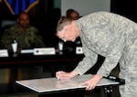 DLA Director Air Force Lt. Gen. Andy Busch signs the 2017 Sexual Assault Awareness and Prevention Month proclamation.