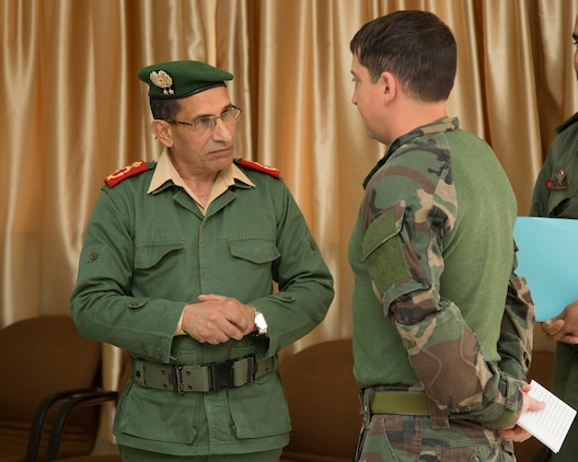 Brig. Gen. Mohammed Benlouali, operations commander for Morocco's Southern Zone, speaks to the lead exercise instructor from a U.S. Marine Corps Forces, Special Operations Command (MARSOC) team at the opening ceremony for Exercise Flintlock 2017 Feb. 27, 2017. This year marks the tenth iteration of the special operations forces exercise, which focuses on building partner capacity and enhancing interoperability between 24 African and Western partners training in seven partner nations. (U.S. Marine Corps Photo by Sgt. Scott A. Achtemeier/ /RELEASED)