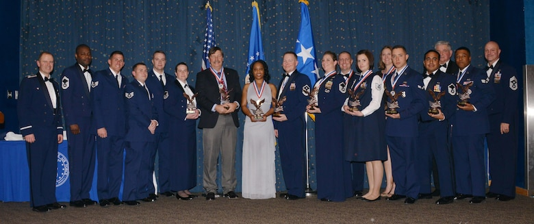 Recipients of the 377th Air Base Wing's annual awards pose with wing leaders at the ceremony earlier this month at Kirtland Air Force Base.