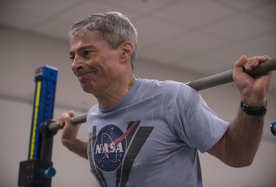 Mark Vande Hei, a retired Army colonel, trains on the advanced resistive exercise device, which astronauts use to stop muscle loss while being weightless in space, at Johnson Space Center in Houston, March 1, 2017. Astronauts can simulate free-weight exercises in normal gravity by using the device's adjustable resistance piston-driven vacuum cylinders to get a load of up to 600 pounds. DoD photo by Sean Kimmons