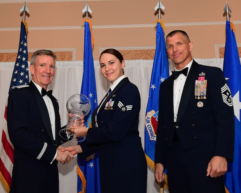 Gen. Hawk Carlisle, commander, Air Combat Command presents an award to Senior Airman Liae Hess, 355th Fighter Wing air traffic controller, Davis-Monthan Air Force Base, Arizona, as Chief Master Sgt. Steve McDonald, command chief, ACC observes during the 2017 Outstanding Airmen of the Year banquet at the Bayview Community Center at  Langley AFB, Virginia, March 8, 2017. The award recognizes 12 outstanding enlisted service members for superior leadership, job performance, community involvement and personal achievements. (U.S. Air Force photo by Staff Sgt. Nick Wilson)