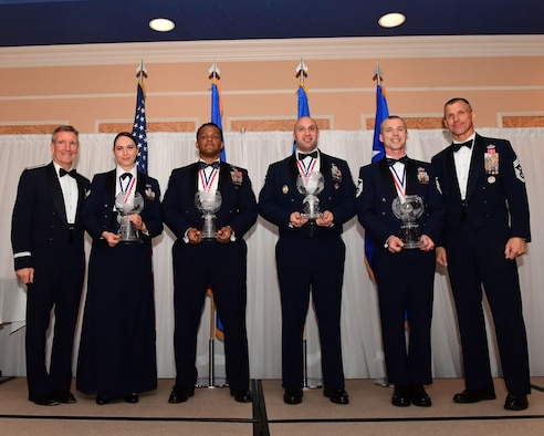 Air Combat Command's 2017 Outstanding Airmen of the Year nominations stand on stage during a banquet at the Bayview Community Center at Langley AFB, Virginia, March 8, 2017. ACC's nominees will represent their command and will compete at the Air Force level. The award recognizes 12 outstanding enlisted service members for superior leadership, job performance, community involvement and personal achievements. (U.S. Air Force photo by Staff Sgt. Nick Wilson)