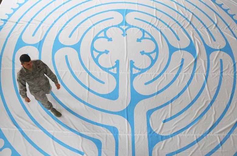 Staff Sgt. Derrick Lehner, 9th Reconnaissance Wing chaplain assistant and noncommissioned officer in charge of Airman community development walks the labyrinth at the Valley Chapel, March 7, 2017, at Beale Air Force Base, California. The labyrinth is a spiritual tool which can be traced back nearly 4,000 years. (U.S. Air Force photo/Airman 1st Class Aubrey Barringer)