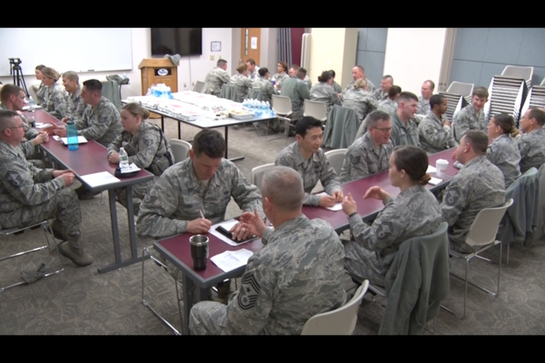 NCO's question Senior NCOs on topics ranging from personal experience to career environments at Pease Air National Guard Base, N.H. Feb. 5. The speed-mentoring event was created as an opportunity for NCOs to build professional relationships and aid their military career. (N.H. Air National Guard still from video by Tech. Sgt. Erica Rowe)