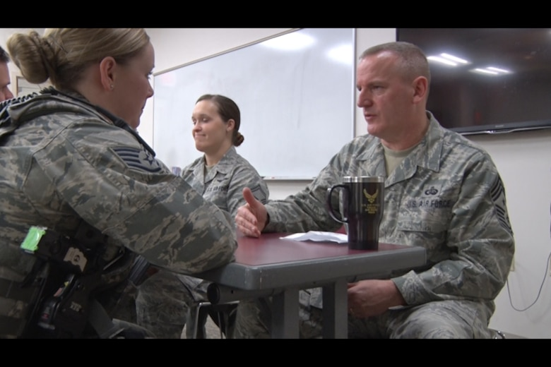 Staff Sgt. Kelsey Hannafin, 157th Security Forces Squadron member, talks with Chief Master Sgt. James Lawrence, 157th Air Refueling Wing Command Chief Master Sergeant, during the speed- mentoring event at Pease Air National Guard Base, N.H. Feb. 5. The event was created as an opportunity for NCOs to build professional relationships and aid their military career. (N.H. Air National Guard still from video by Tech. Sgt. Erica Rowe)