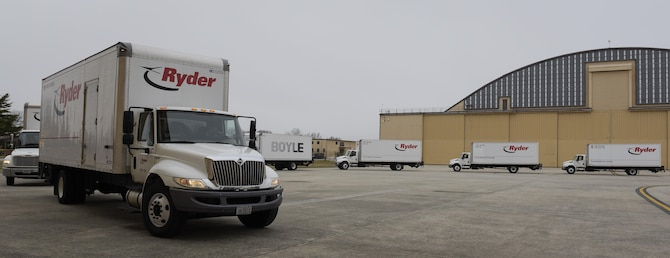 """Trucks containing materials from President Obama's administration pull up outside of a hangar on Joint Base Andrews, Md. Feb. 14, 2017. Standing by to receive the materials were Joint Records Team (JRT) members made up of Airmen assigned to the Air Force District of Washington (AFDW) and Soldiers from the U.S. Army's 3rd Infantry Division """"The Old Guard"""" worked in concert with Presidential Material Handlers from the National Archives and Records Management (NARA) over several months to ensure the safe movement of the records and artifacts gathered during the eight years of President Obama's administration. The JRT was tasked with helping to inventory, prepare for shipping, palletize and load several tons of paper records, terabytes of electronic records, and thousands of artifacts. Along with several truck shipments the bulk of the materials were loaded onto and Air Force C-5 Galaxy cargo aircraft brought in from Dover Air Force Base, Del., and were then flown to Chicago, Ill., where they were placed in secure storage until completion of Obama's Presidential Library. The library is part of the presidential library system, which is administered by the National Archives and Records Administration. (U.S. Air Force photo/Jim Varhegyi) (released)"""