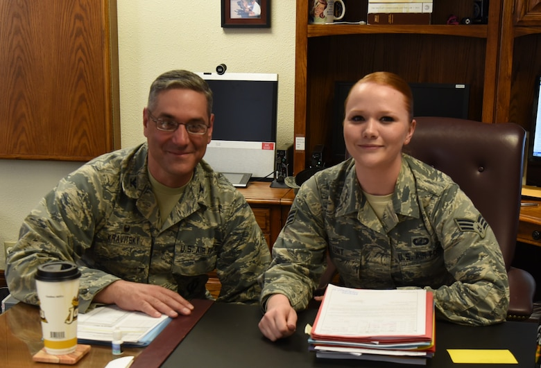 Col. Stephen Kravitsky, 90th Missile Wing commander and Senior Airman Cheryl Lunt, 90th Comptroller Squadron financial analyst technician, pause for a photo after spending the day together at F.E. Warren Air Force Base, Wyo., March 8, 2017. The shadowing program allows junior Airmen to accompany the commander for a day to learn how senior leaders lead the wing, tackle issues and make critical decisions. (U.S. Air Force Photo by 1st Lt Esther Willett)