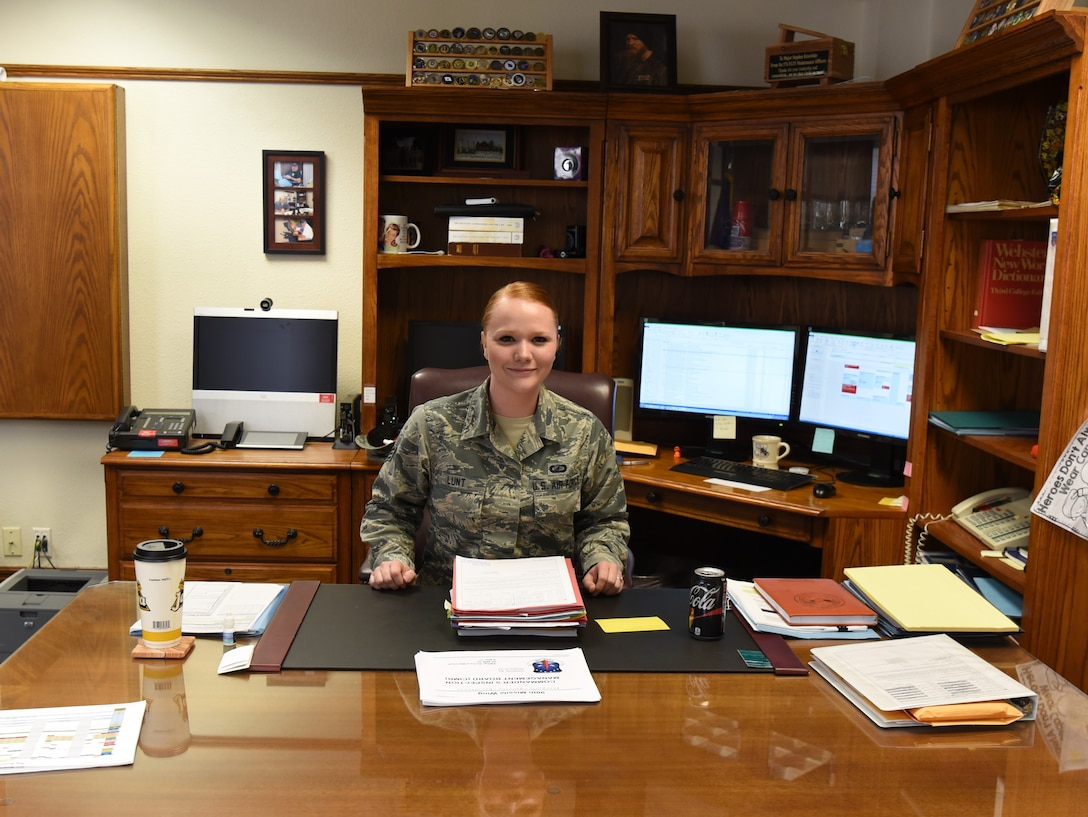 Senior Airman Cheryl Lunt, 90th Comptroller Squadron financial analyst technician, sits at the wing commander's desk after shadowing Col. Stephen Kravitsky, 90th Missile Wing commander, for the day at F.E. Warren Air Force Base, Wyo., March 8, 2017. The shadowing program allows junior Airmen to accompany the commander for a day to learn how senior leaders lead the wing, tackle issues and make critical decisions. (U.S. Air Force Photo by 1st Lt Esther Willett)