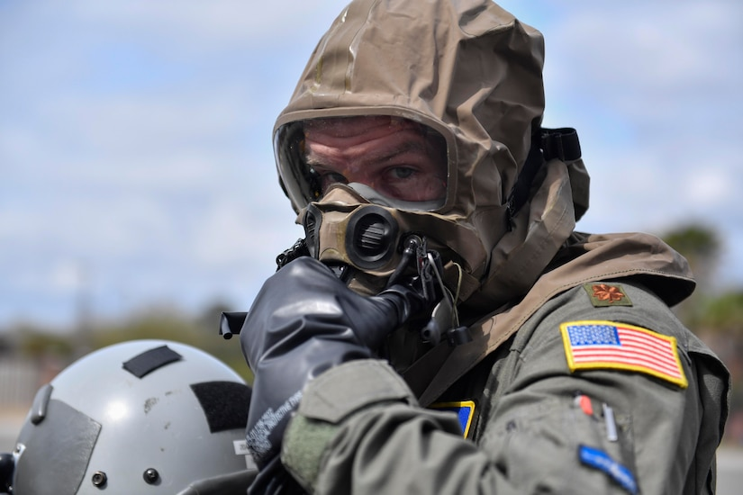 Major Chris De Winnie, 16th Airlift Squadron pilot, wears chemical, biological, radiological and nuclear (CBRN) gear during Exercise Bonny Jack 2017 on the flightline here, March 8, 2017. Exercise Bonny Jack 2017 is a three-part readiness exercise for the 437th Airlift Wing. The first major event in the exercise was a two-day mobility exercise March 1 and 2, followed by a CBRN exercise. Bonny Jack 2017 will conclude with a large-formation exercise in May.