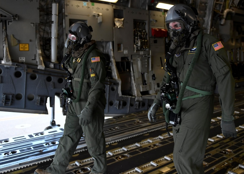 Staff Sgt. Jason Conner, left, 16th Airlift Squadron loadmaster, and Staff Sgt. Javier Lopez exit a C-17 Globemaster III during Exercise Bonny Jack 2017 on the flightline here, March 8, 2017. Exercise Bonny Jack 2017 is a three-part readiness exercise for the 437th Airlift Wing. The first major event in the exercise was a two-day mobility exercise March 1 and 2, followed by a CBRN exercise. Bonny Jack 2017 will conclude with a large-formation exercise in May.