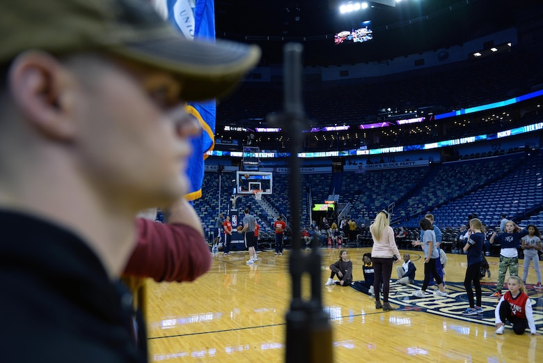 Members of the New Orleans Pelicans, a local dance troupe and the Keesler Honor Guard practice their respective routines during pregame warmups before a New Orleans Pelicans NBA game at the Smoothie King Center, March 3, 2017, in New Orleans. The Keesler Honor Guard posted the colors prior to the game. The Keesler Honor Guard performs hundreds of ceremonial details across Louisiana and Mississippi each year, including funerals, ceremonies, sporting events and parades. (U.S. Air Force photo by Senior Airman Duncan McElroy)