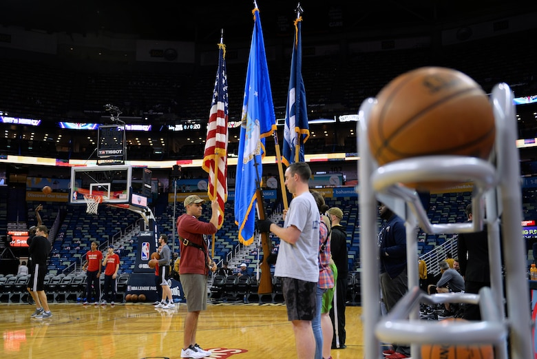 Keesler Honor Guard members practice their routine before a New Orleans Pelicans NBA game at the Smoothie King Center, March 3, 2017, in New Orleans. The Keesler Honor Guard posted the colors prior to the game. The Keesler Honor Guard performs hundreds of ceremonial details across Louisiana and Mississippi each year, including funerals, ceremonies, sporting events and parades. (U.S. Air Force photo by Senior Airman Duncan McElroy)