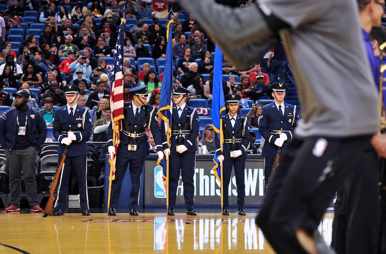 Staff Sgt. Anthony O'Conner-Geiling, Keesler Honor Guard Charlie Flight NCO in charge, does a final check of his Airmen before presenting the colors at a New Orleans Pelicans NBA game at the Smoothie King Center, March 3, 2017, in New Orleans. Each year, the Keesler Honor Guard performs hundreds of ceremonial details across Louisiana and Mississippi, including funerals, ceremonies, sporting events and parades. (U.S. Air Force photo by Senior Airman Duncan McElroy)