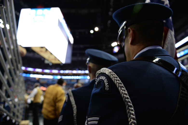 Staff Sgt. Anthony O'Conner-Geiling, Keesler Honor Guard Charlie flight NCO in charge, waits to march onto the court at the New Orleans Pelicans NBA game at the Smoothie King Center, March 3, 2017, in New Orleans, La. The Keesler Honor Guard posted the colors prior to the game and performs hundreds of ceremonial details across Louisiana and Mississippi each year, including funerals, ceremonies, sporting events and parades. (U.S. Air Force photo by Senior Airman Duncan McElroy)