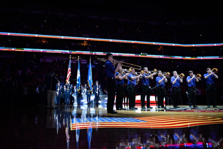 The Keesler Honor Guard presents the colors while the Louisiana State University band performs the national anthem at a New Orleans Pelicans NBA game at the Smoothie King Center, March 3, 2017, in New Orleans. Each year, the Keesler Honor Guard performs hundreds of ceremonial details across Louisiana and Mississippi, including funerals, ceremonies, sporting events and parades. (U.S. Air Force photo by Senior Airman Duncan McElroy)