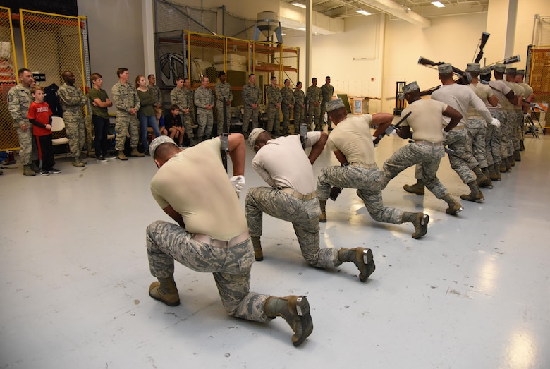 The U.S. Air Force Honor Guard Drill Team performs their new routine for base leadership at the Roberts Consolidated Aircraft Maintenance Facility March 2, 2017, on Keesler Air Force Base, Miss. The team developed a new routine at Keesler during the past five weeks that they will use throughout the year. The team will unveil the routine at the 81st Training Group drill down competition March 10, 2017. (U.S. Air Force photo by Kemberly Groue)