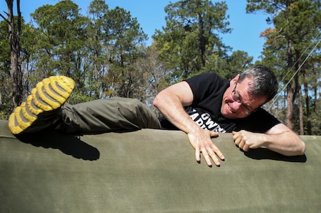 James Rumbaugh a school counselor at Charles D. Owen High School participates in the confidence course during the Recruiting Station Atlanta/Columbia Educators Workshop aboard Marine Corps Recruit Depot Parris Island, South Carolina, Mar. 9, 2017. These participants come from both Recruiting Station Atlanta and Columbia to experience the Educators Workshop. The Educators Workshop provides an opportunity for educators to have an inside look at the Marine Corps to better inform students in their respective schools. (U.S. Marine Corps photo by Lance Cpl. Jack A. E. Rigsby/Released)