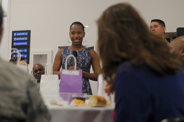 U.S. Air Force Staff Sgt. Tracy Sims, the NCO in charge of readiness and training assigned to the 6th Air Mobility Wing chaplain corps speaks during a luncheon for Women's History Month at MacDill Air Force Base, Fla., March 9, 2017. Sims spoke in the perspective of Hattie Wyatt Caraway, the first woman to be elected to serve a full term in the U.S. Senate. (U.S. Air Force photo by Airman 1st Class Adam R. Shanks)