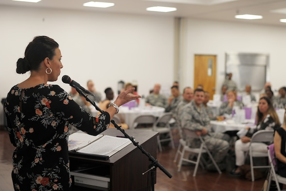 """Stephanie Reed, wife of Col. Clifton Reed, the commander of the 6th Maintenance Group, speaks during the """"Who Am I?"""" luncheon tea at MacDill Air Force Base, Fla., March 9, 2017. Reed offered words of encouragement to all attendees during the event honoring trailblazing women during Women's History Month. (U.S. Air Force photo by Airman 1st Class Adam R. Shanks)"""