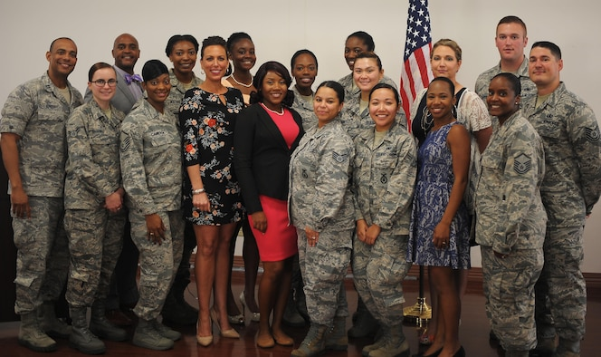 Members of Team MacDill's Women's History Month committee pause for a group photo following a luncheon at MacDill Air Force Base, Fla., March 9, 2017. The committee coordinated the luncheon in honor of Women's History Month. (U.S. Air Force photo by Airman 1st Class Adam R. Shanks)