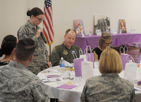 U.S. Air Force Airman 1st Class Paulette Shanks, a firetruck mechanic assigned to the 6th Logistics Readiness Squadron speaks during a luncheon for Women's History month at MacDill Air Force Base, Fla., March 9, 2017. Shanks spoke in the perspective of Ibtihaj Muhammad, a Muslim woman who was the first to wear a hijab during the 2016 Olympic Games. (U.S. Air Force photo by Airman 1st Class Adam R. Shanks)