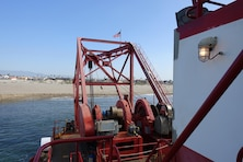 The hydraulic cutter-head suction dredge H.R. Morris digs up sediment from the Channel Islands Harbor sand trap Feb. 14. Seattle-based Manson Construction, the Corps' contractor for the project, piped the material to nearby Hueneme Beach to replenish sand lost to erosion.